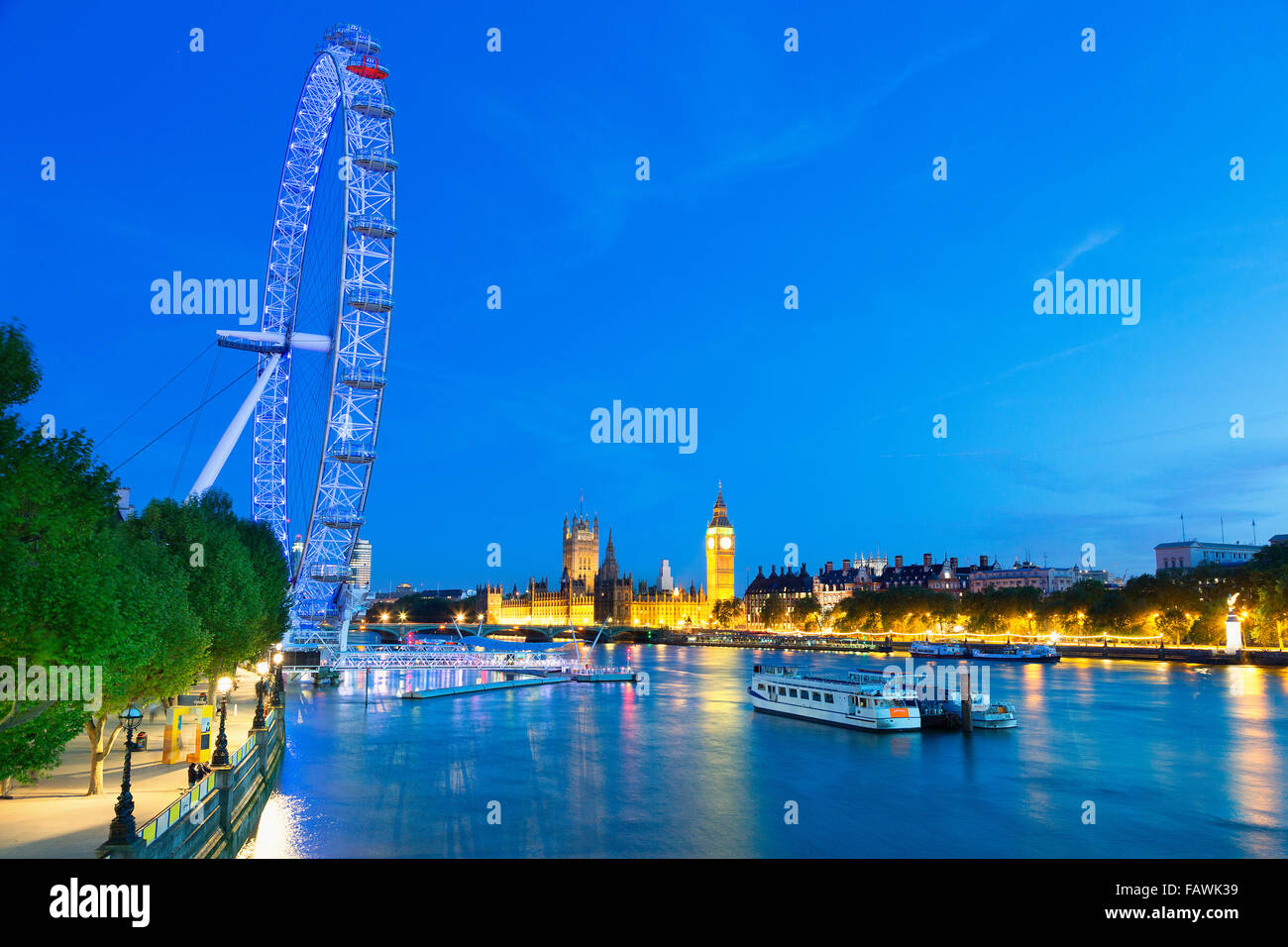Cityscape of London, view on Parliament houses and millennium wheel - Stock Image