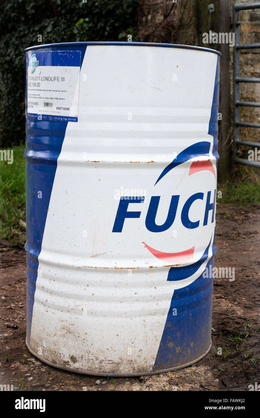 Oil drum being used as gate obstruction - Stock Image