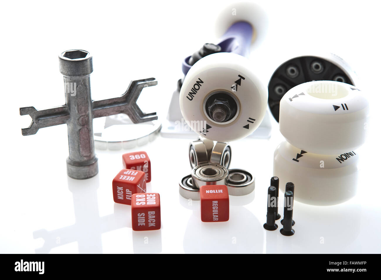 Skate Board Wheels Wrench bolts and bearings on a background - Stock Image