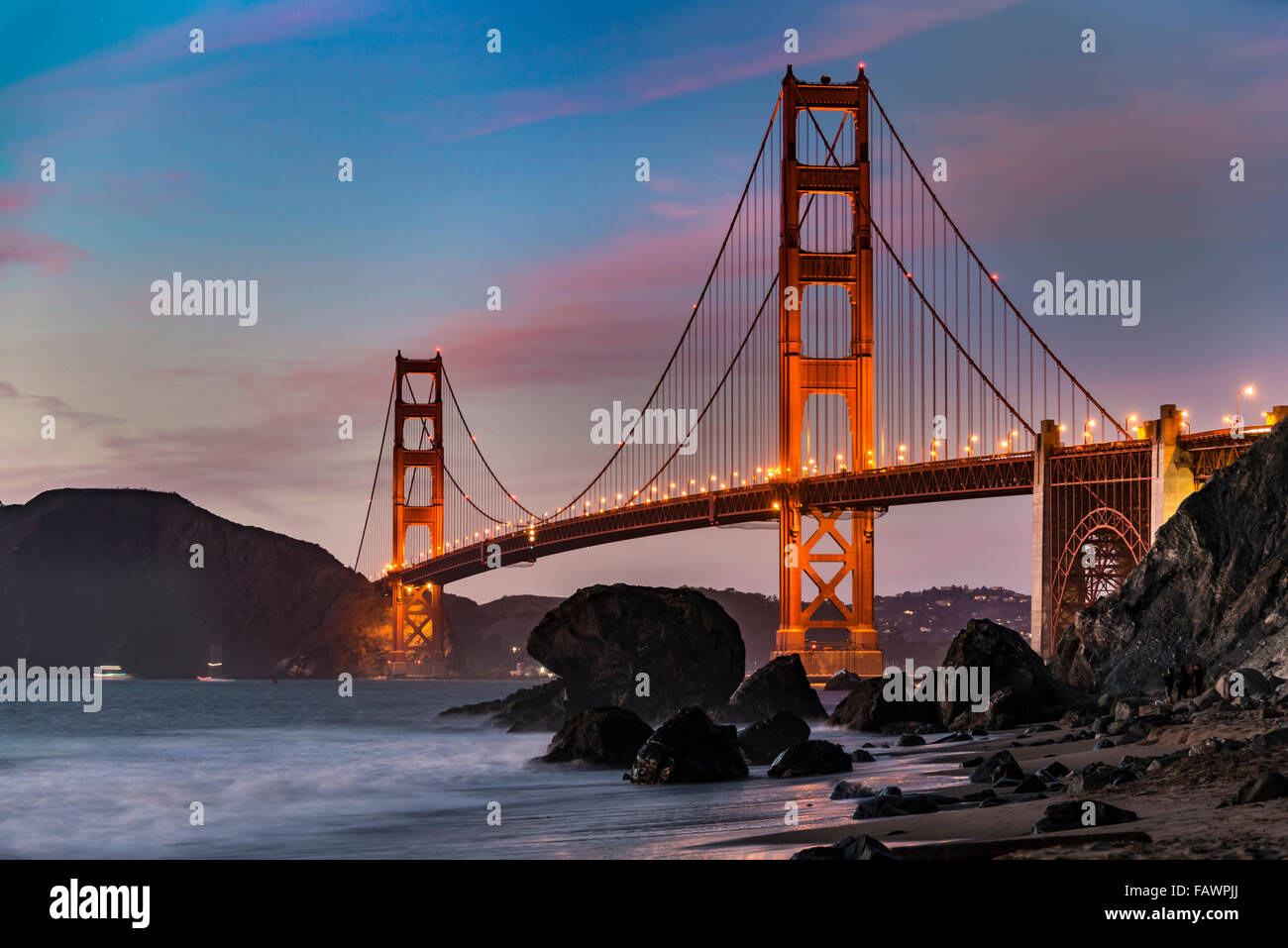 Golden Gate Bridge, Marshall's beach, night, rocky coast, San Francisco, USA - Stock Image