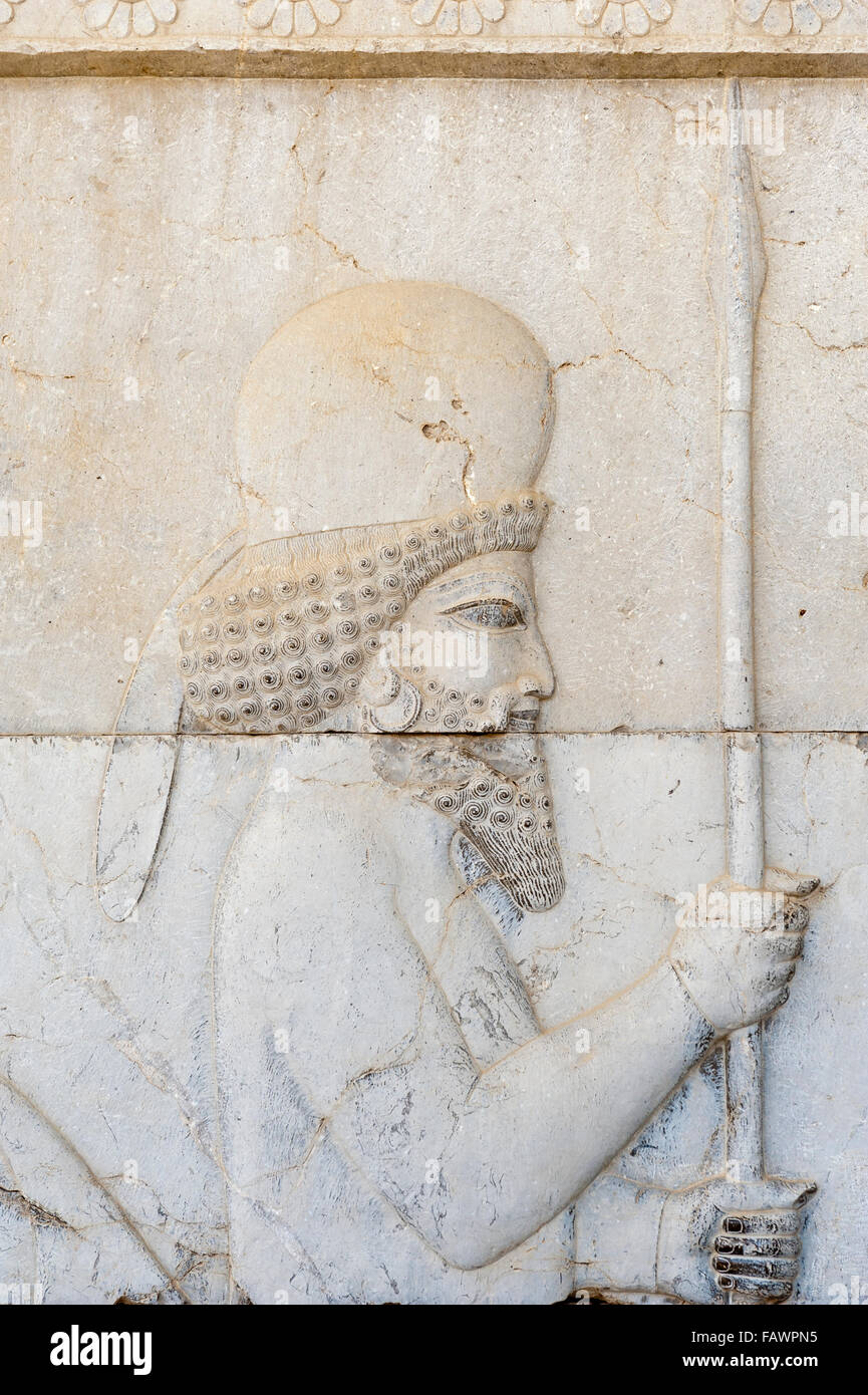 Ancient relief of the Achaemenids, Meder with lance, soldier of Immortal Guard, outer wall of the Apadana Palace - Stock Image