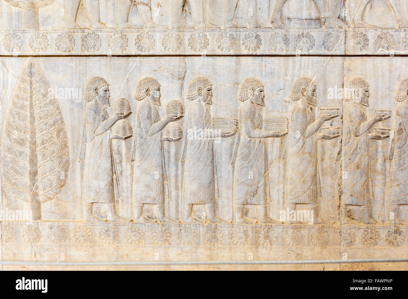 Ancient relief of the Achaemenids, delegation of the Ionians, Apadana Palace, archaeological site - Stock Image