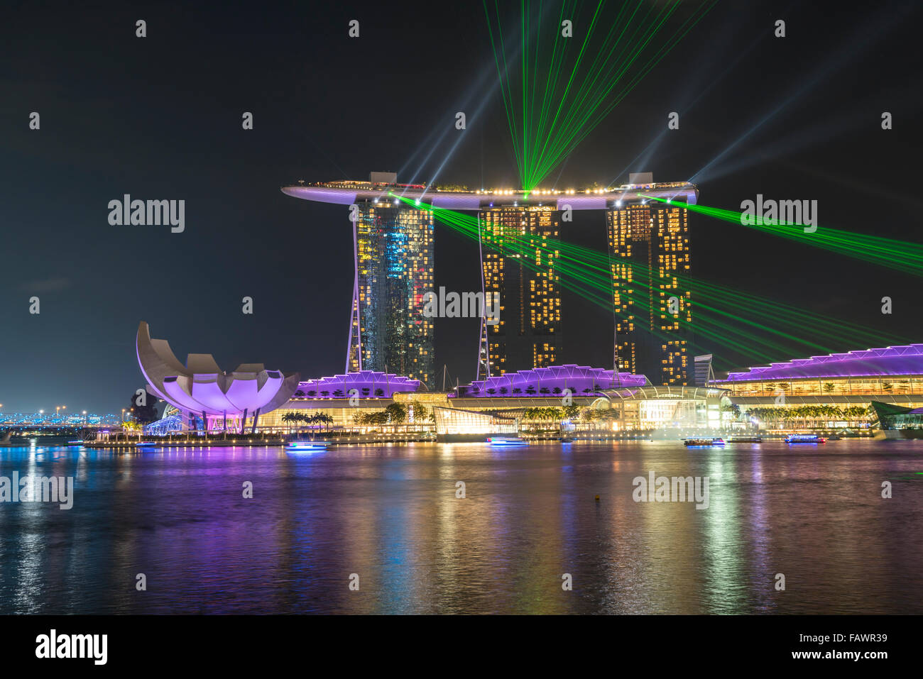 Laser show at Marina Bay Sands Hotel in the evening, Marina Bay, Singapore - Stock Image