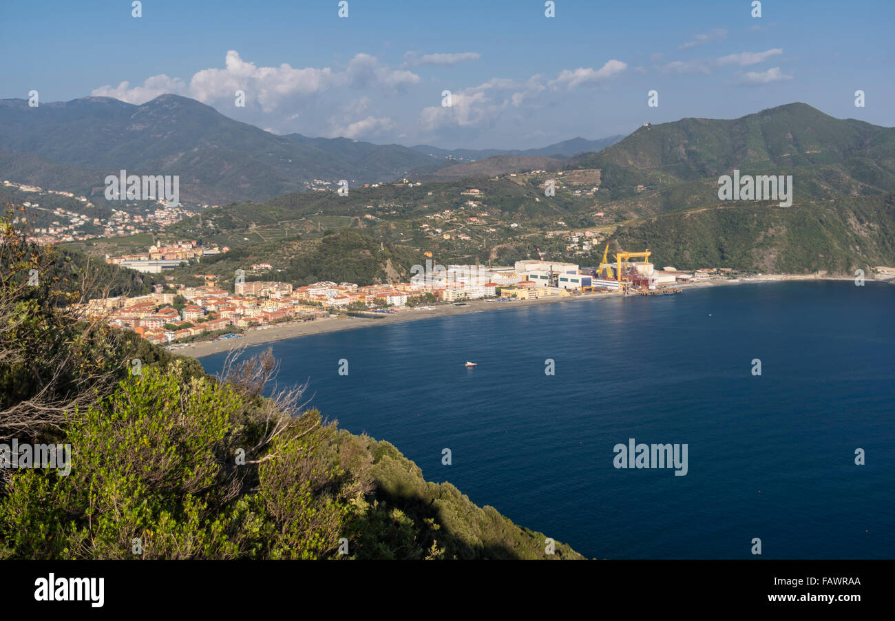 View of the coastal town of Riva Trigoso, Liguria, Italy, and its shipbuilding docks. - Stock Image