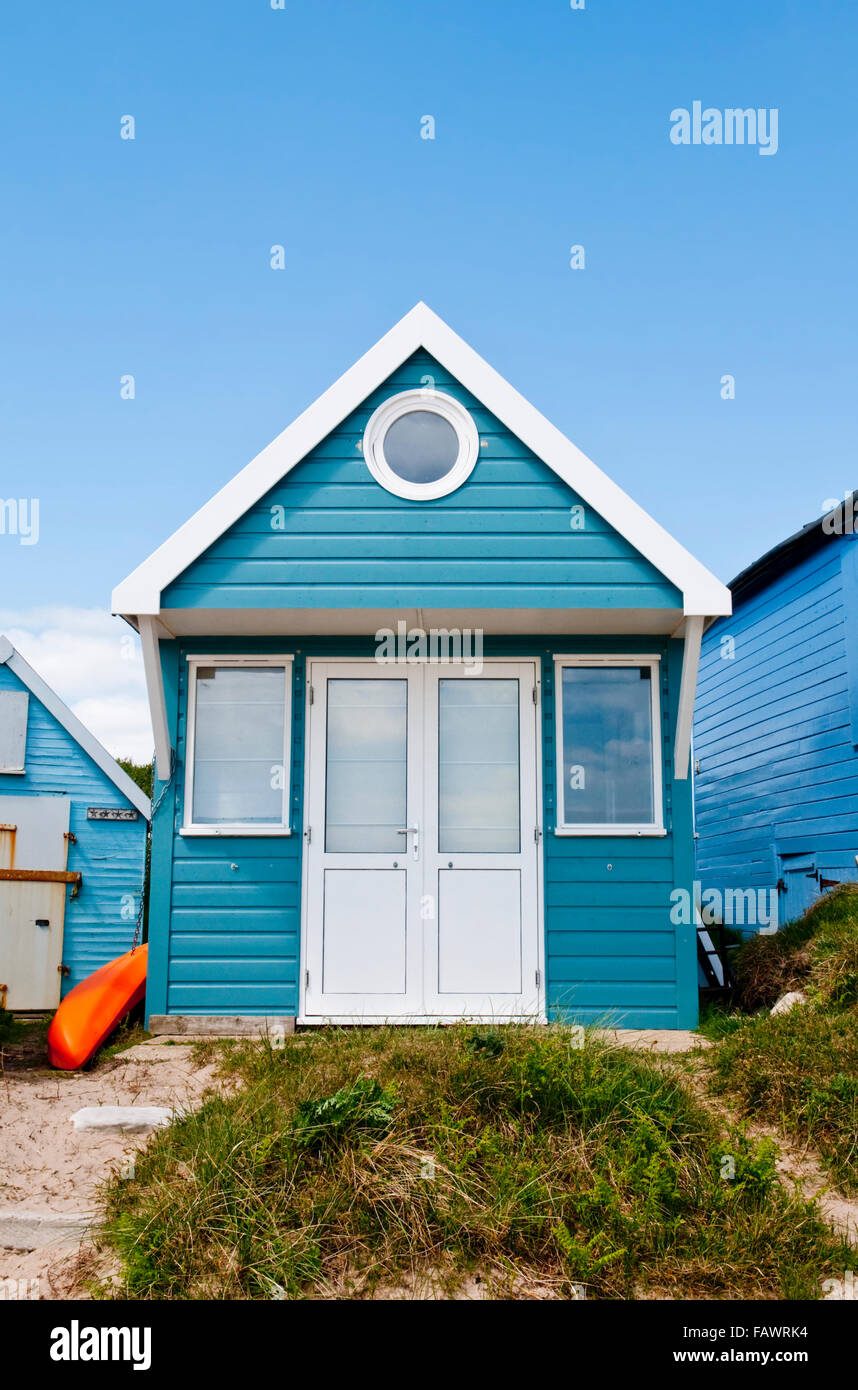 A blue and white beach hut at Mudeford Sandbank, Hengistbury Head, near Christchurch, Dorset, UK - Stock Image