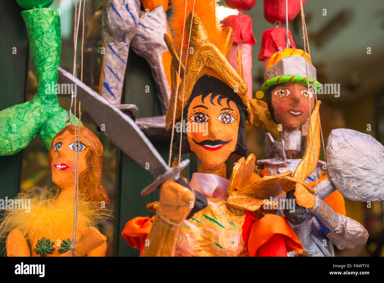 Puppets, view of colorful traditional papier mache puppets for sale on the Corso Umberto l in Taormina, Sicily. - Stock Image