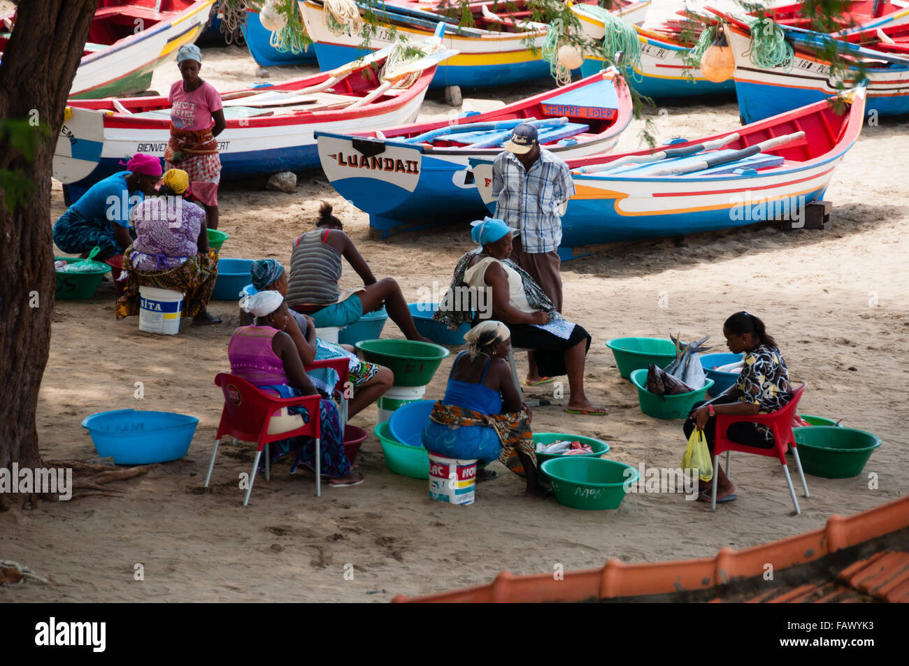 African people men womean and boat with fish on the sand beach in cape verde - Stock Image