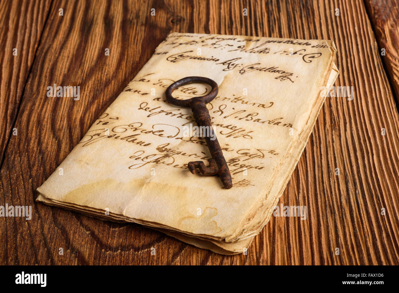 Old key on letter background Stock Photo