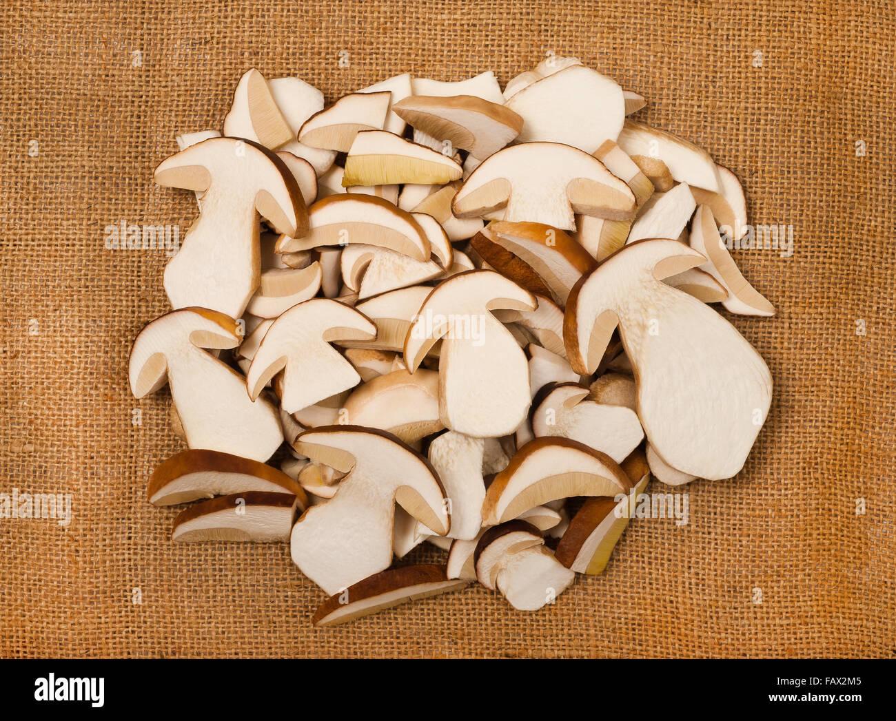 sliced mushrooms on jute background Stock Photo