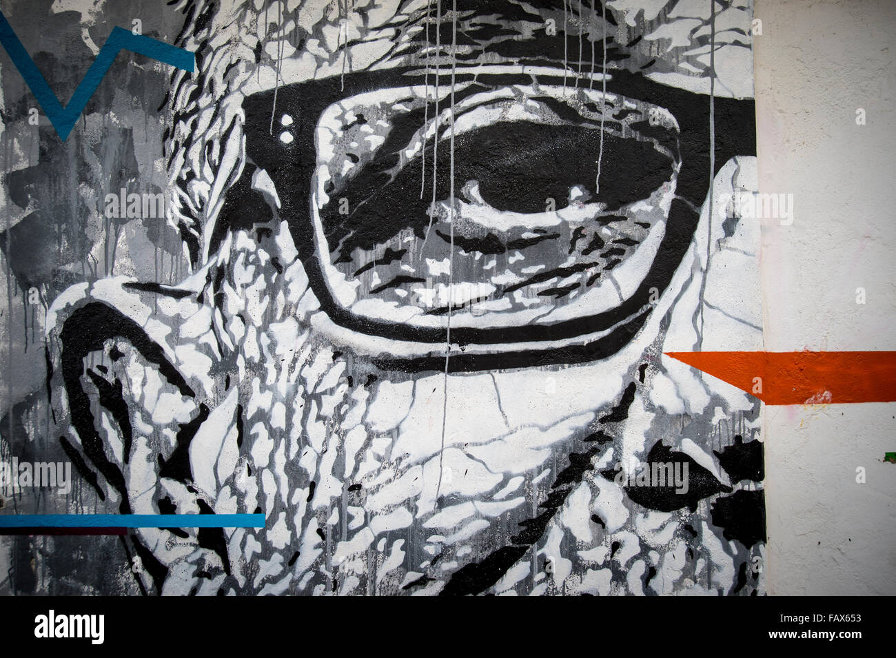 graffiti of a mans face painted on the wall of an abandoned building in Lagos Portugal. - Stock Image