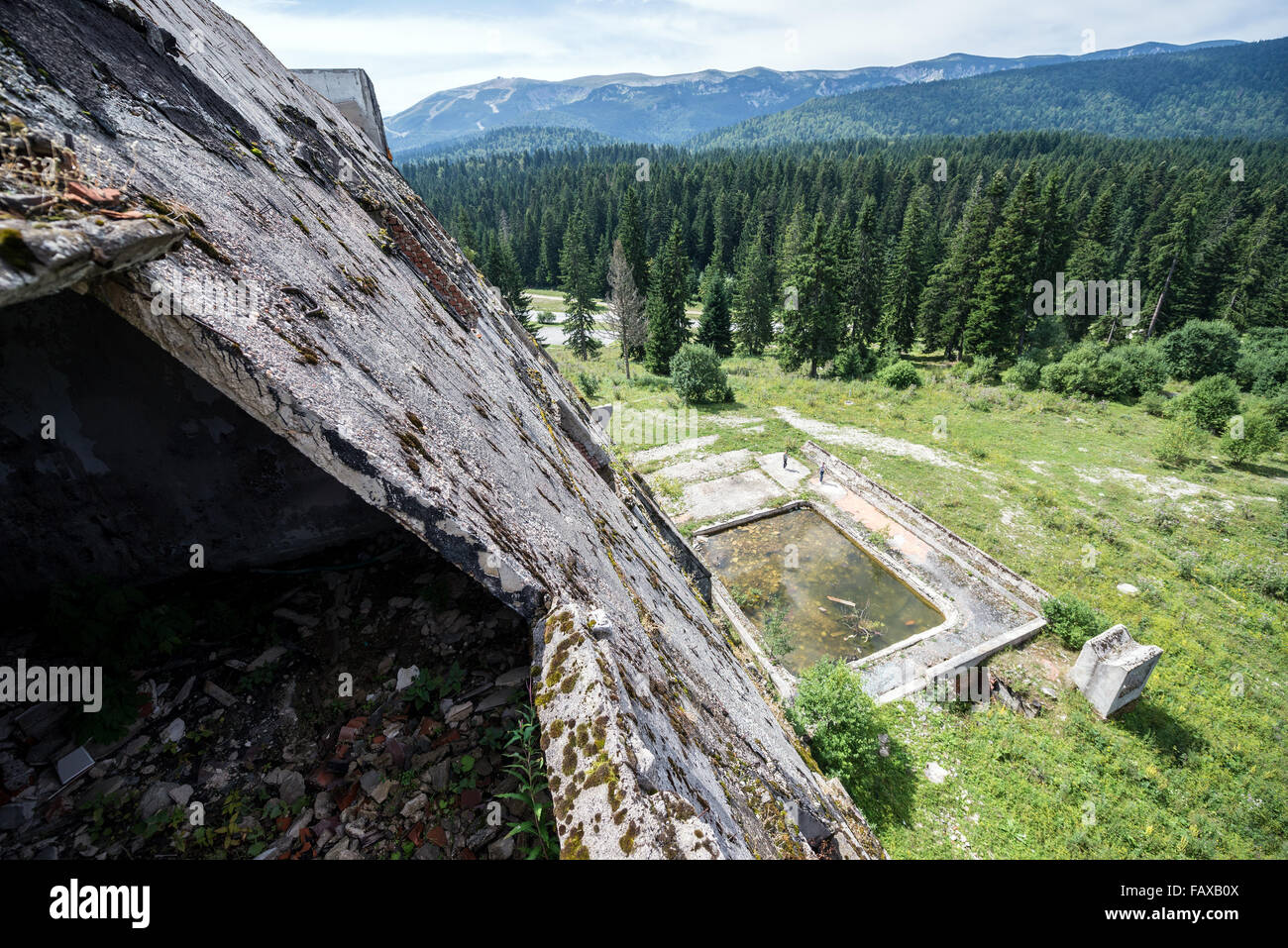 Ruins of Igman Hotel near Igman Olympic Jumps, destroyed during Bosnian War in Bosnia and Herzegovina - Stock Image