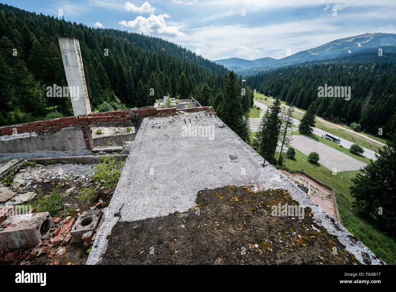 on the roof of ruined Igman Hotel near Igman Olympic Jumps, destroyed during Bosnian War in Bosnia and Herzegovina - Stock Image
