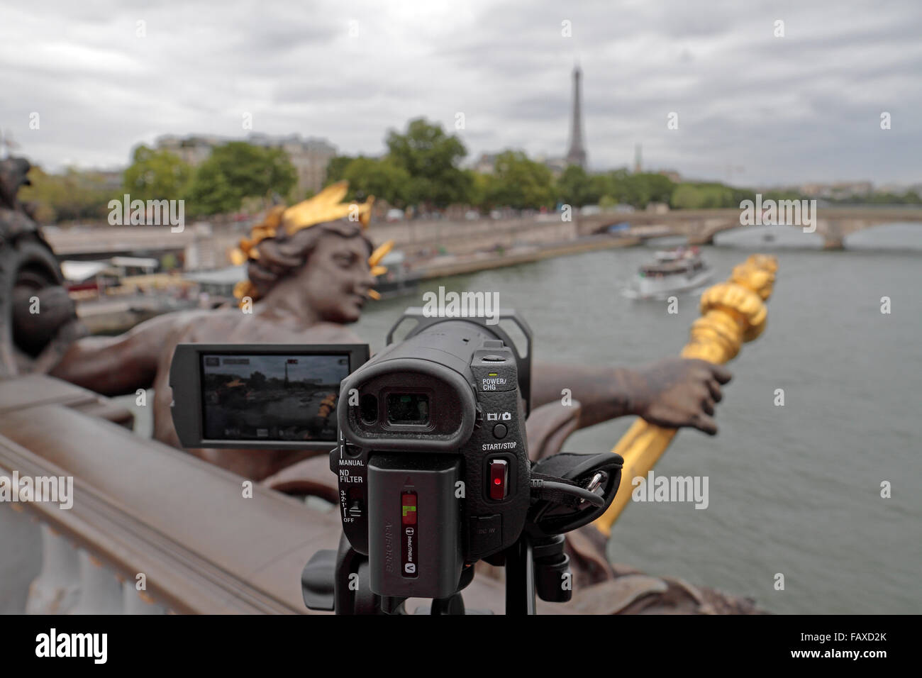 View past a 4k video camera on a tripod looking along the River Seine in Paris, France. - Stock Image