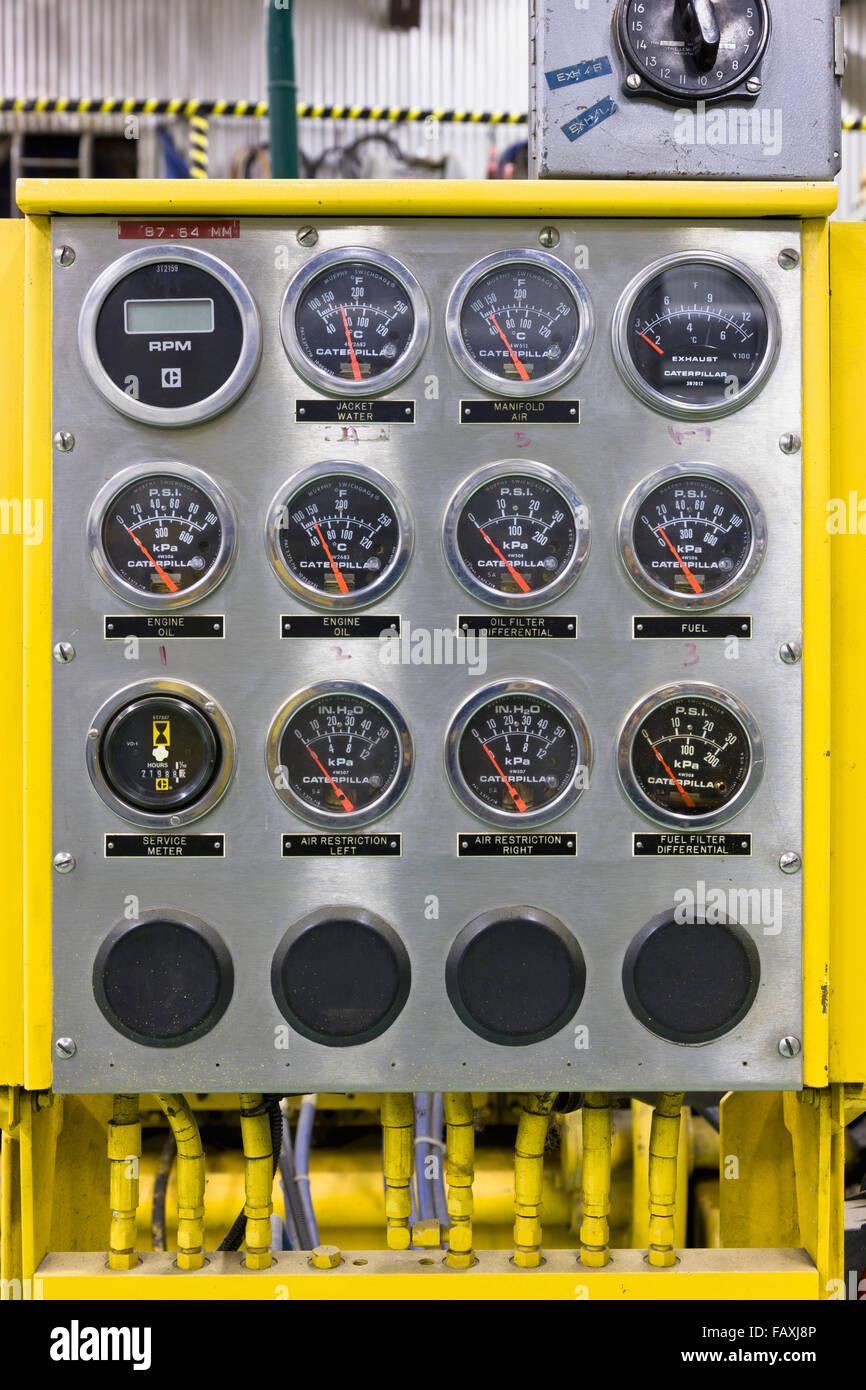 Indicator readouts and switches on a control panel at an electrical ...