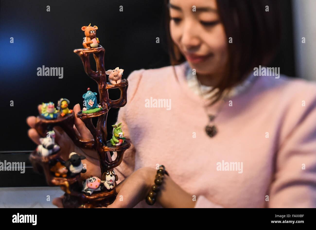 Changchun, China's Jilin Province. 5th Jan, 2016. Dough modelling maker Li Jing dsiplays her works '12 Chinese - Stock Image