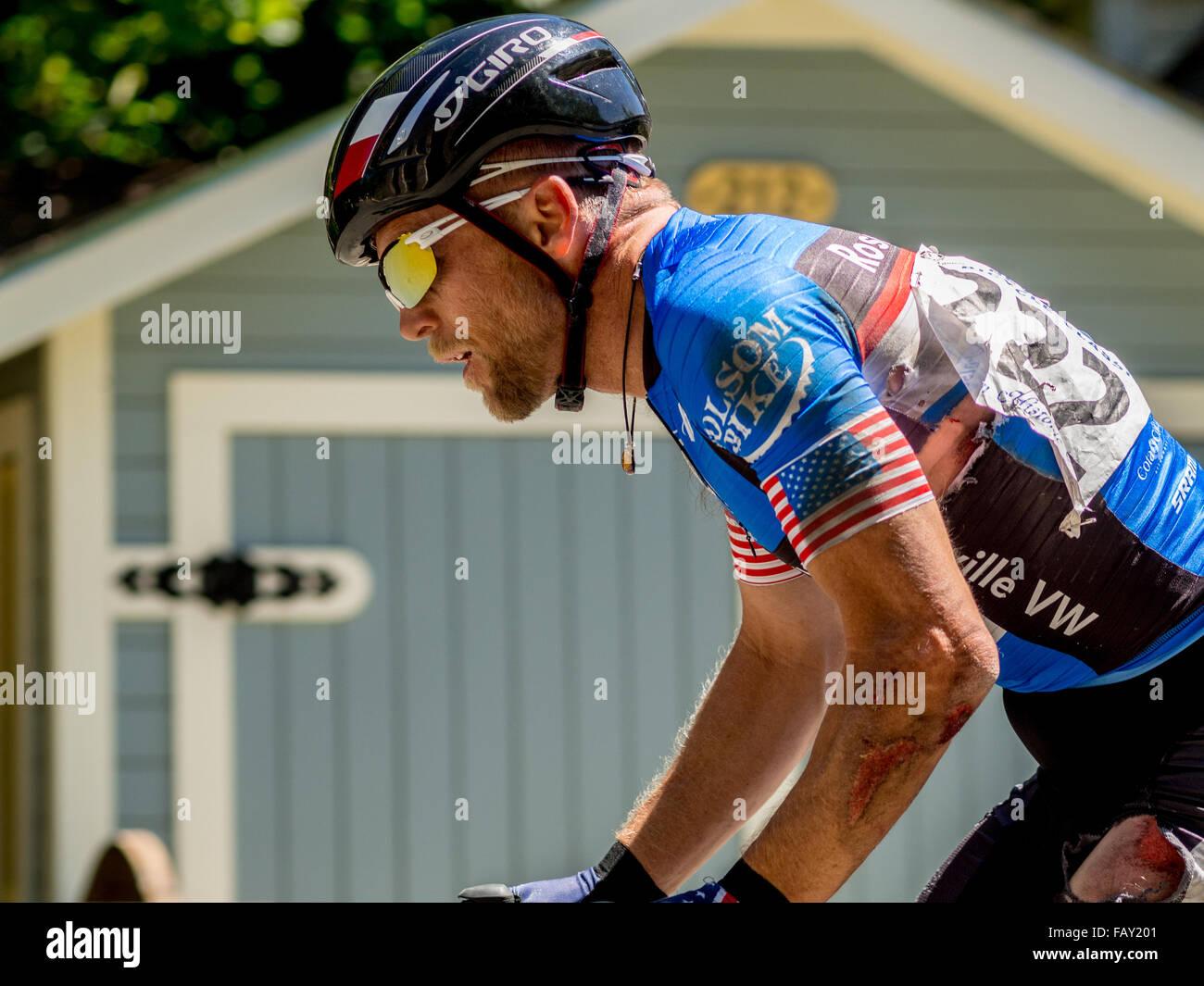 NEVADA CITY, USA - JUNE 14, 2014: Master's age group athlete rides despite injury after crashing in cycling - Stock Image