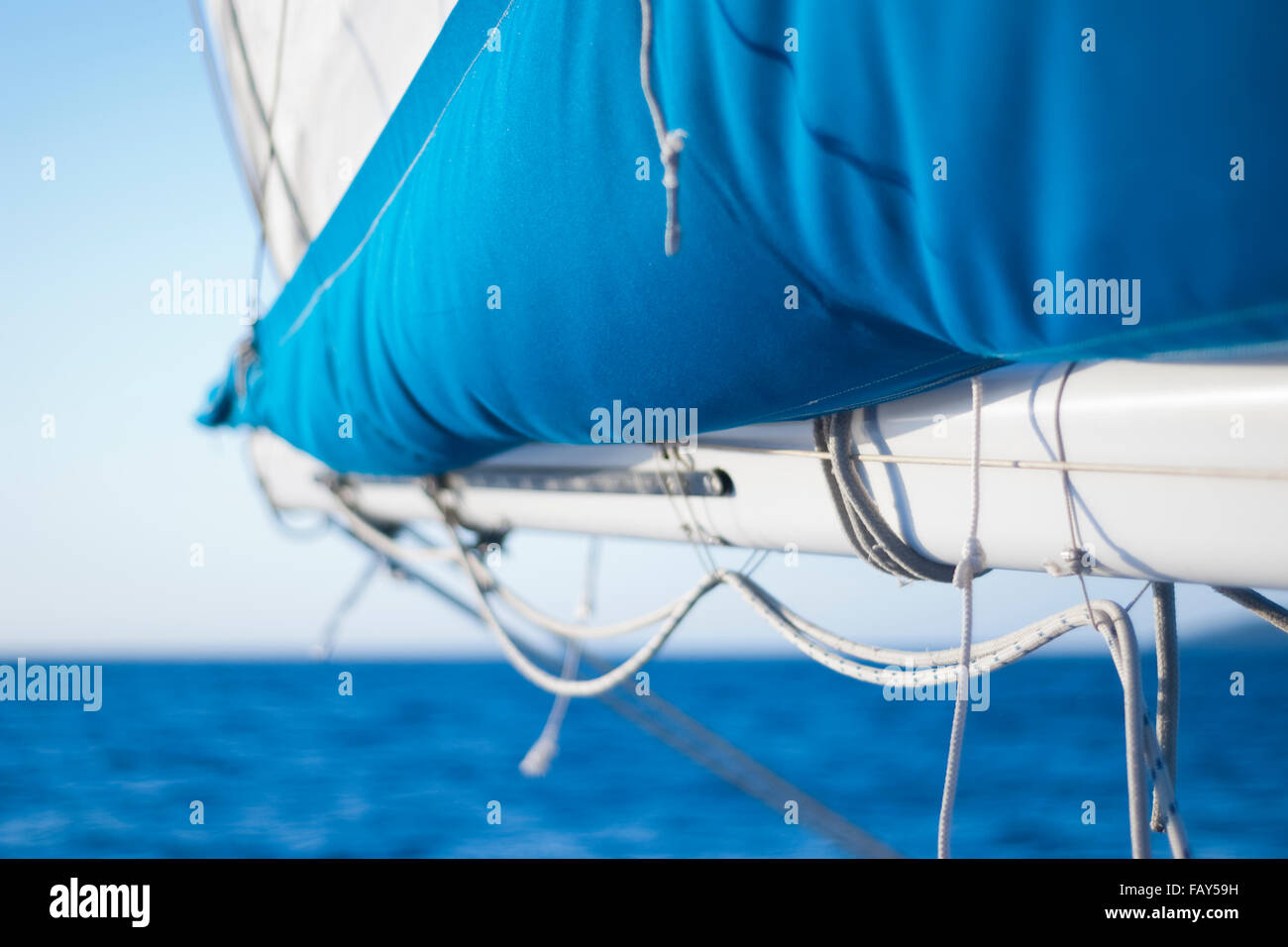 Boom and sail cover on a sloop. - Stock Image