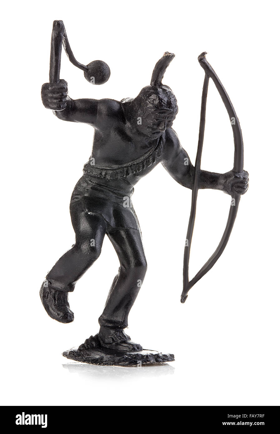 North American indian with mace and bow close-up isolated on white . Miniature figurine of a children's toy. - Stock Image