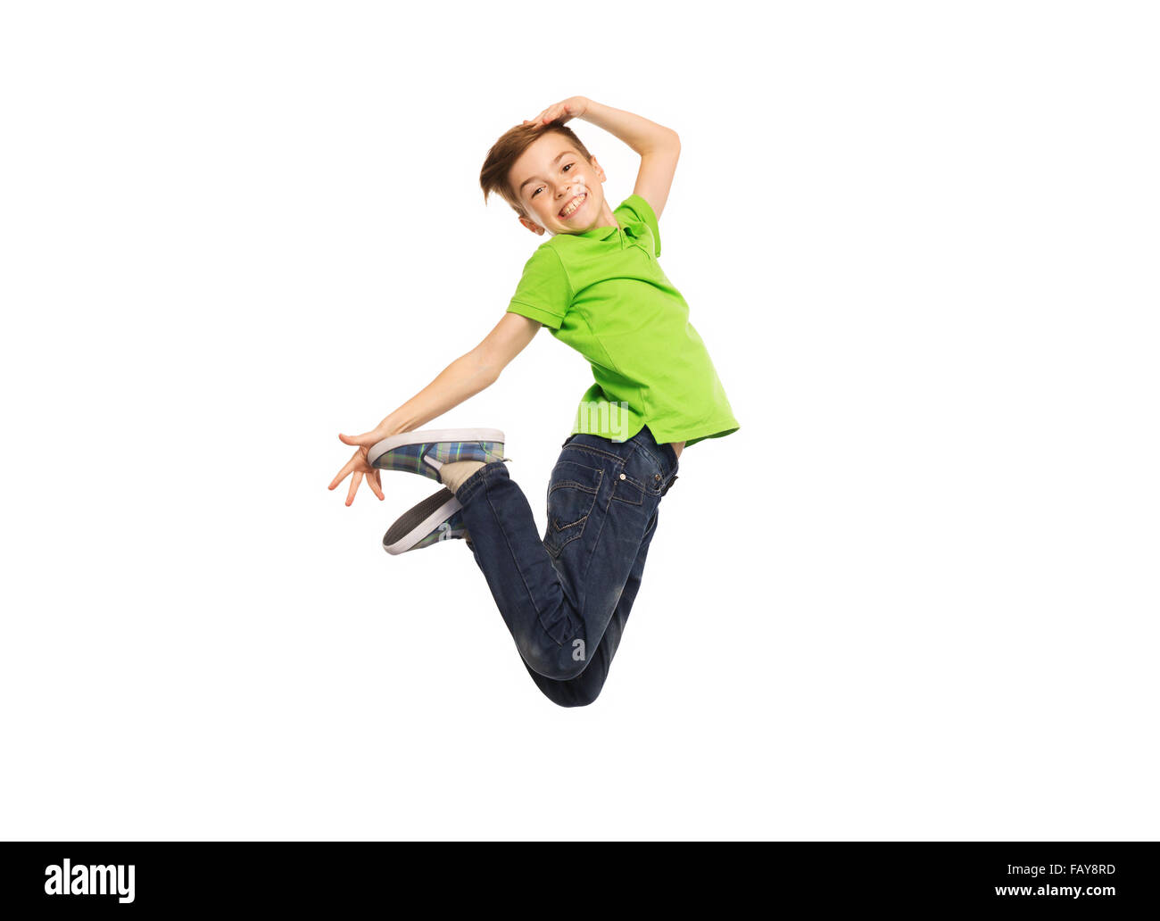 smiling boy jumping in air - Stock Image