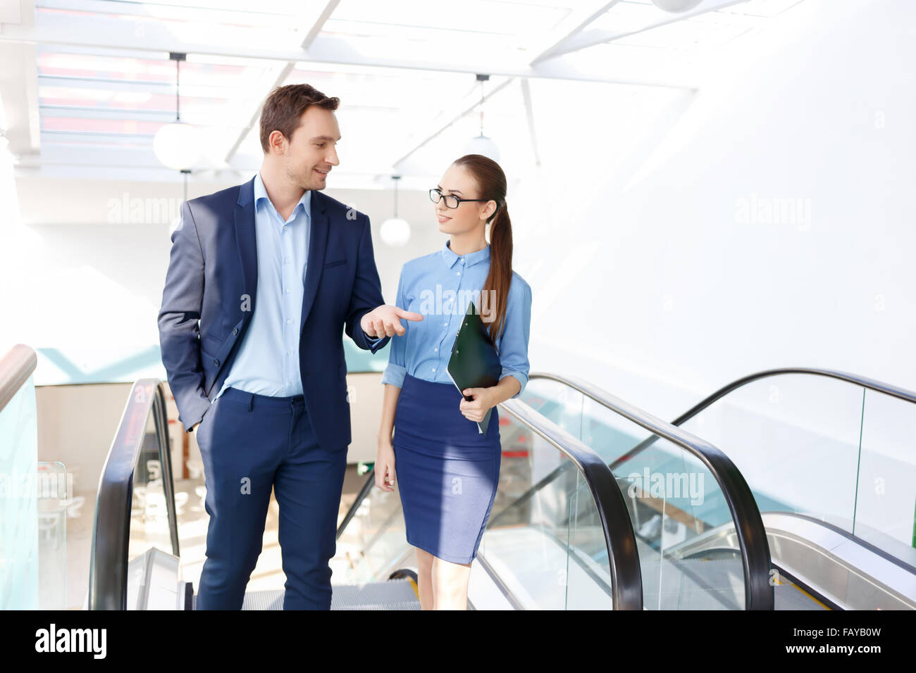 Workman is chitchatting with his office friend. - Stock Image