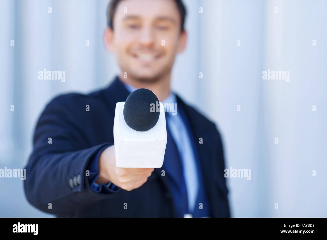 Affable newsman is listening to the interviewed. - Stock Image