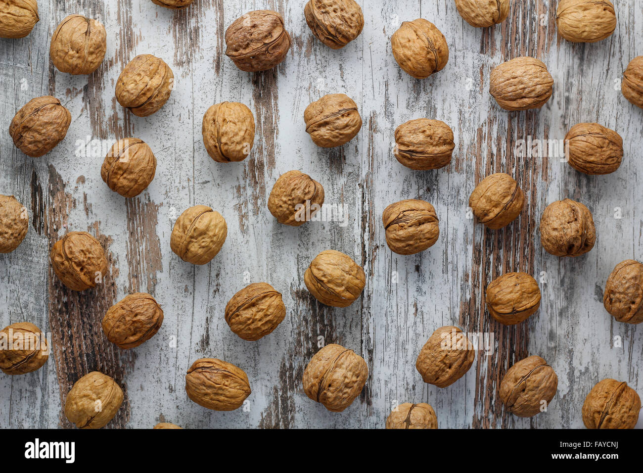 Walnuts in a wood background - Stock Image