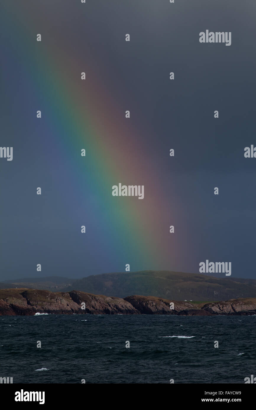 Rainbow over Mull. View from Port Romain, Iona across The Sound. Inner Hebrides.  Argyll and Bute, west coast Scotland. - Stock Image