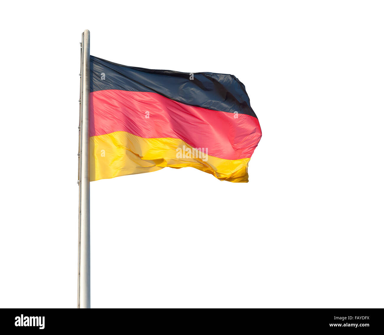 The German flag flying on a metal pole, isolated on a white background - Stock Image