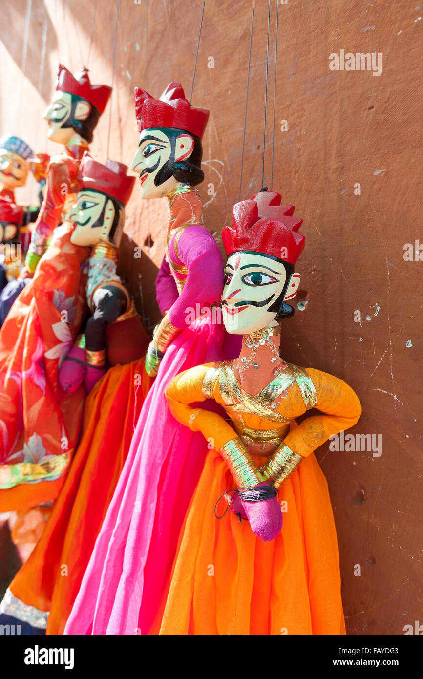 Indian string puppets hanging by a wall. The puppets are used in traditional Rajasthani Theatre called Kathputli. - Stock Image