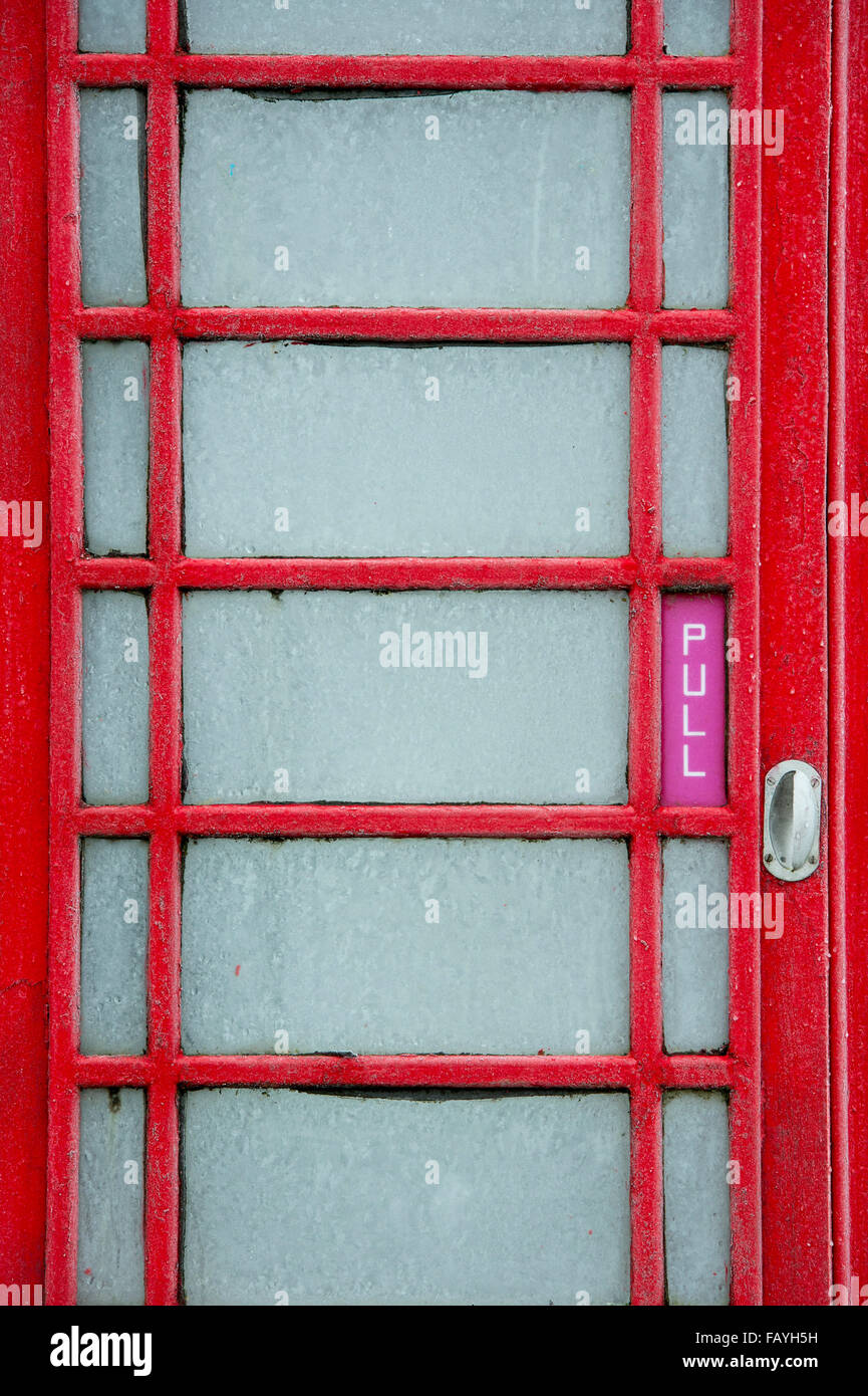 Old red telephone box covered in frost. UK - Stock Image