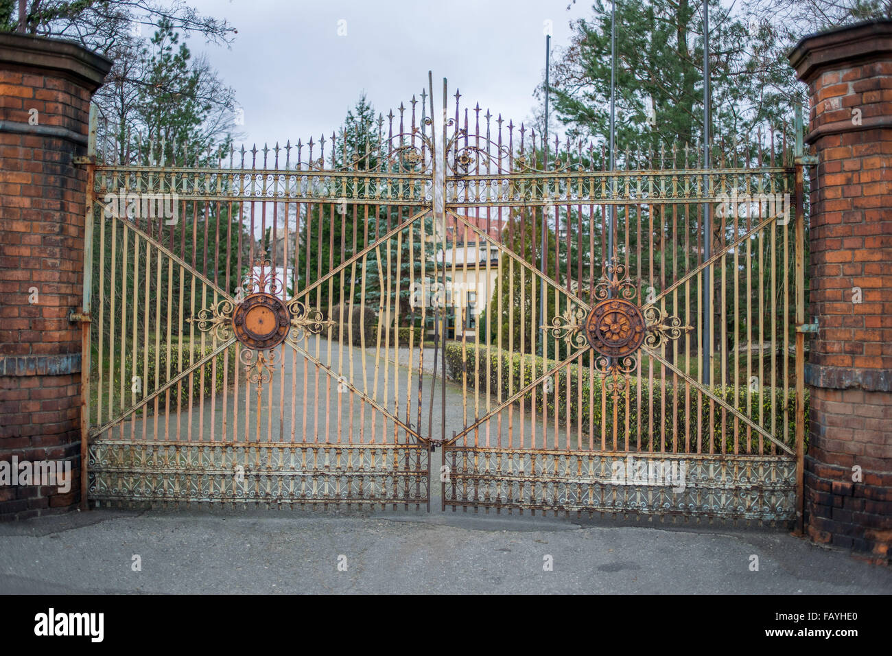 Old worn out ornamental iron gate - Stock Image
