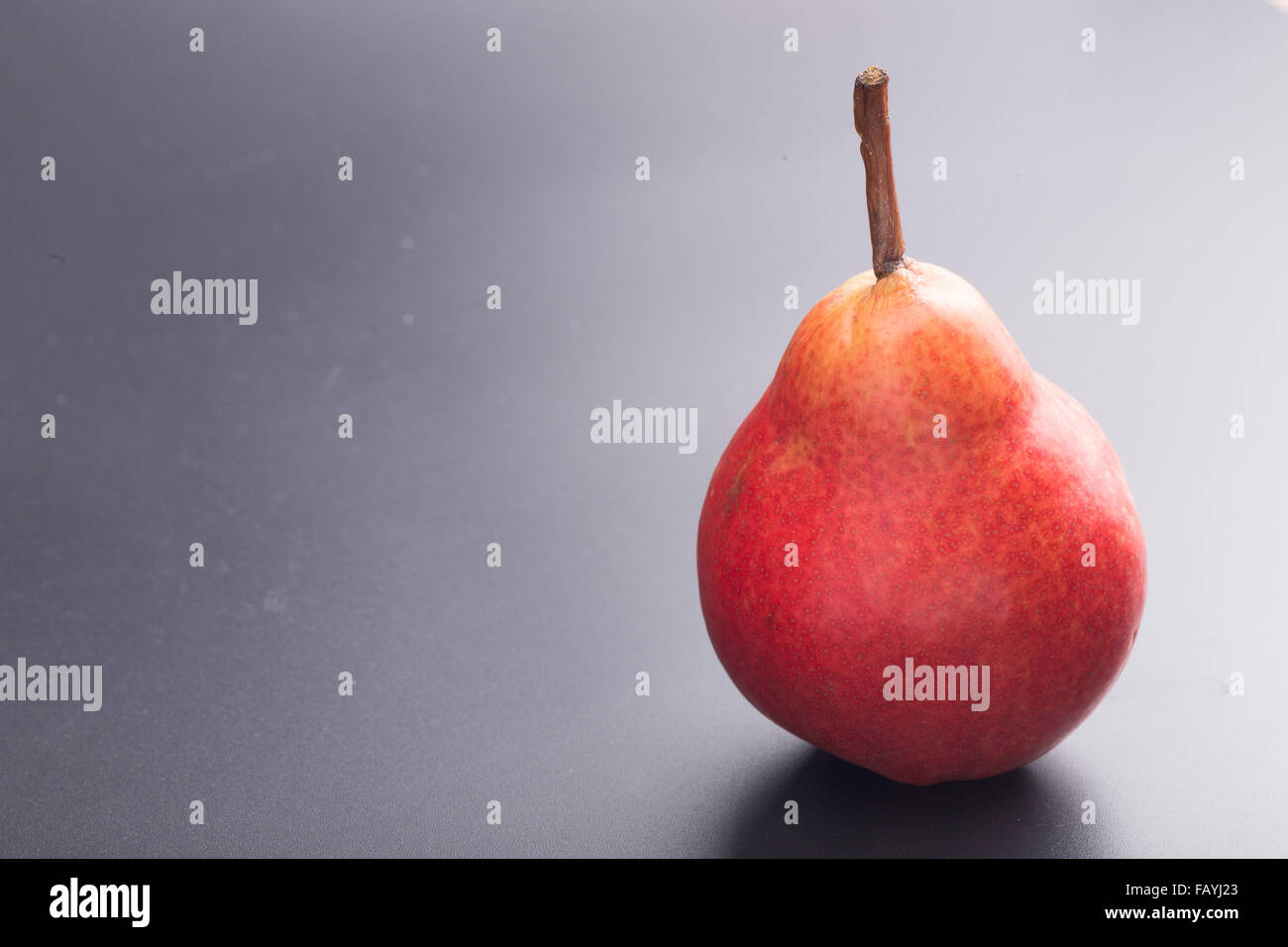 Williams pear isolated on black - Stock Image