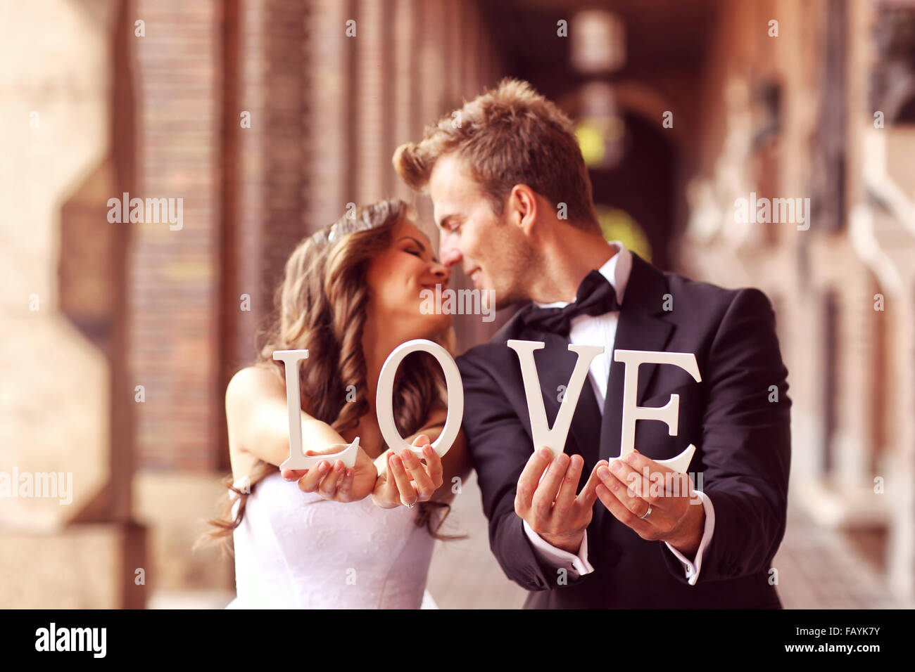 happy bride and groom holding love letters stock image