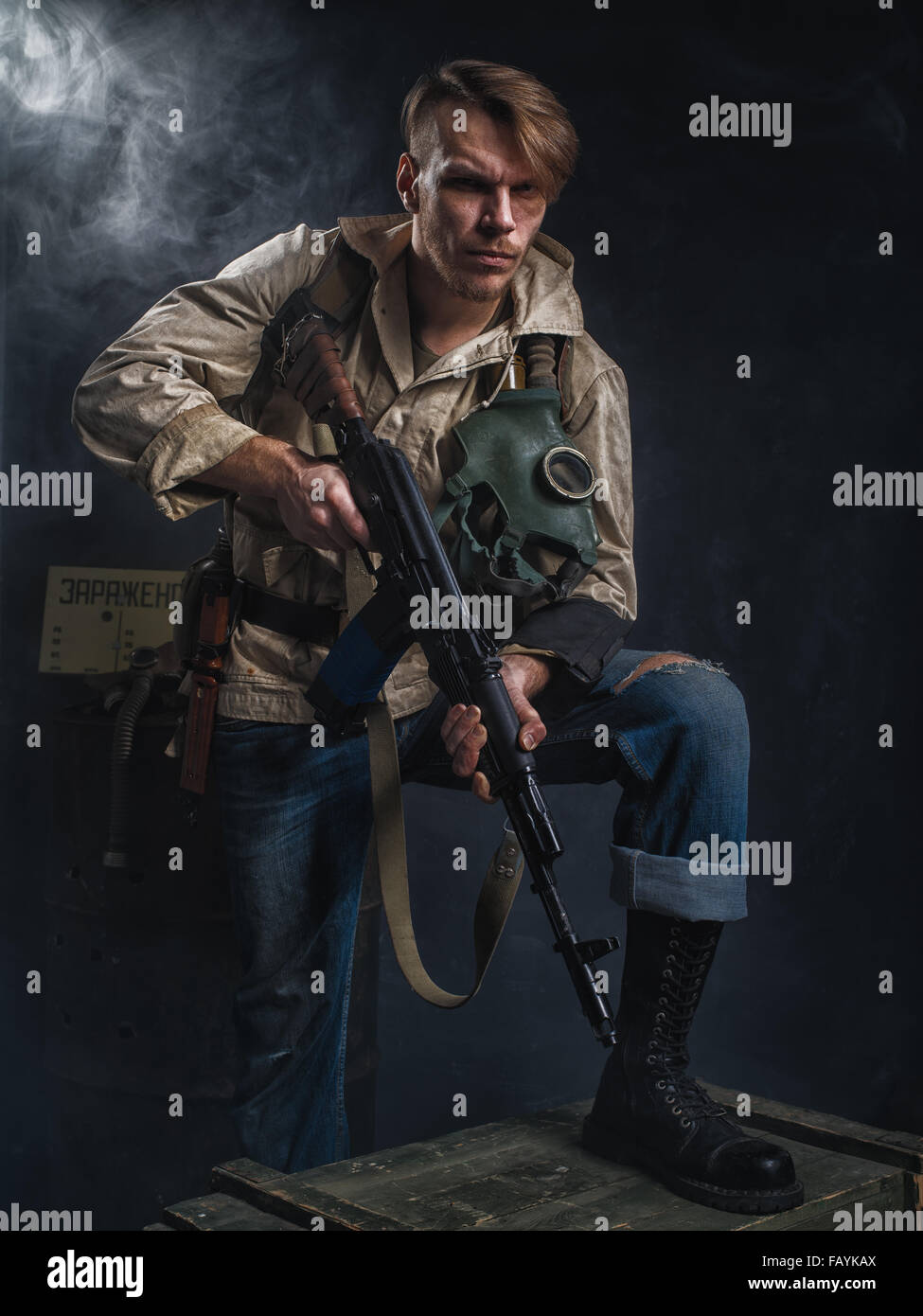Armed man with a gun. Post-apocalyptic fiction. Stalker. - Stock Image