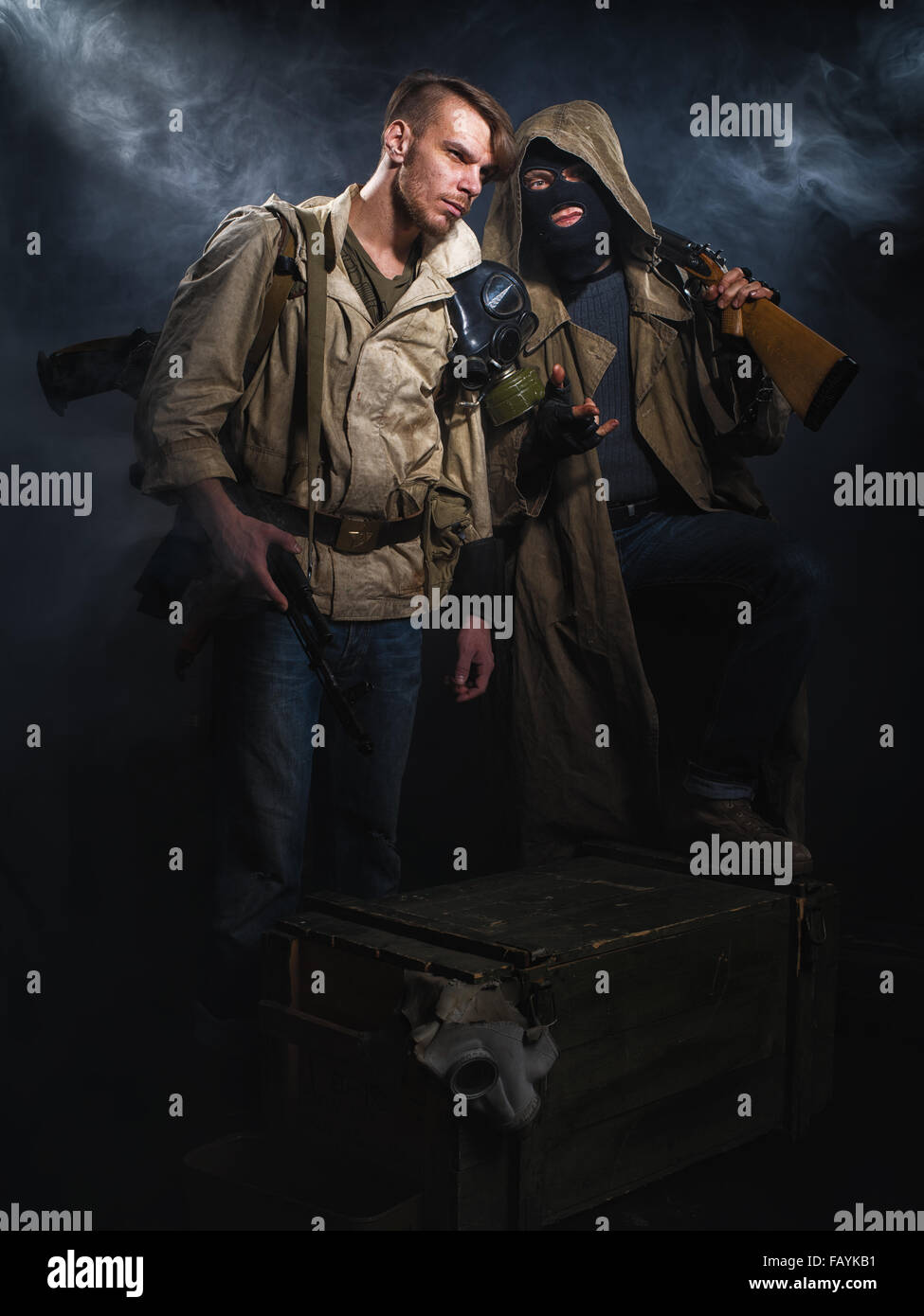 Two armed men. Post-apocalyptic fiction. Stalker. - Stock Image