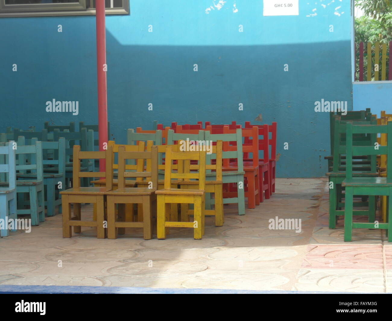 schoolyard with wooden chairs - Stock Image