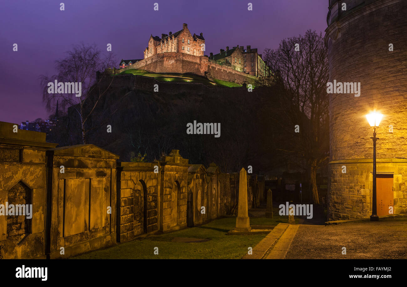 View of the magnificent Edinburgh Castle from the churchyard of St. Cuthberts Church. - Stock Image
