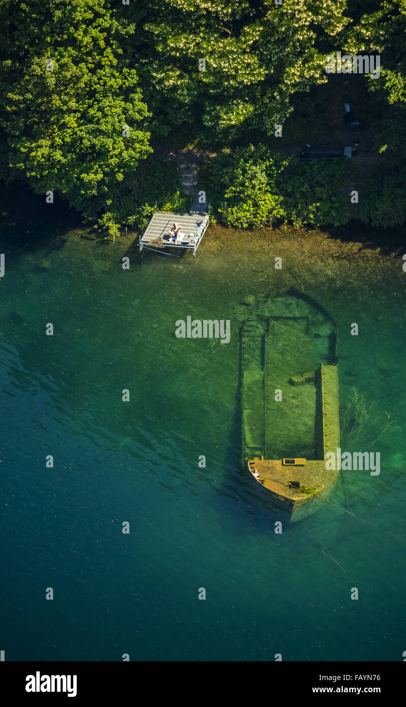 Aerial view, sunken boat with fishermen on Escher lake in Cologne, green turquoise waters, Cologne, Rhineland, Stock Photo