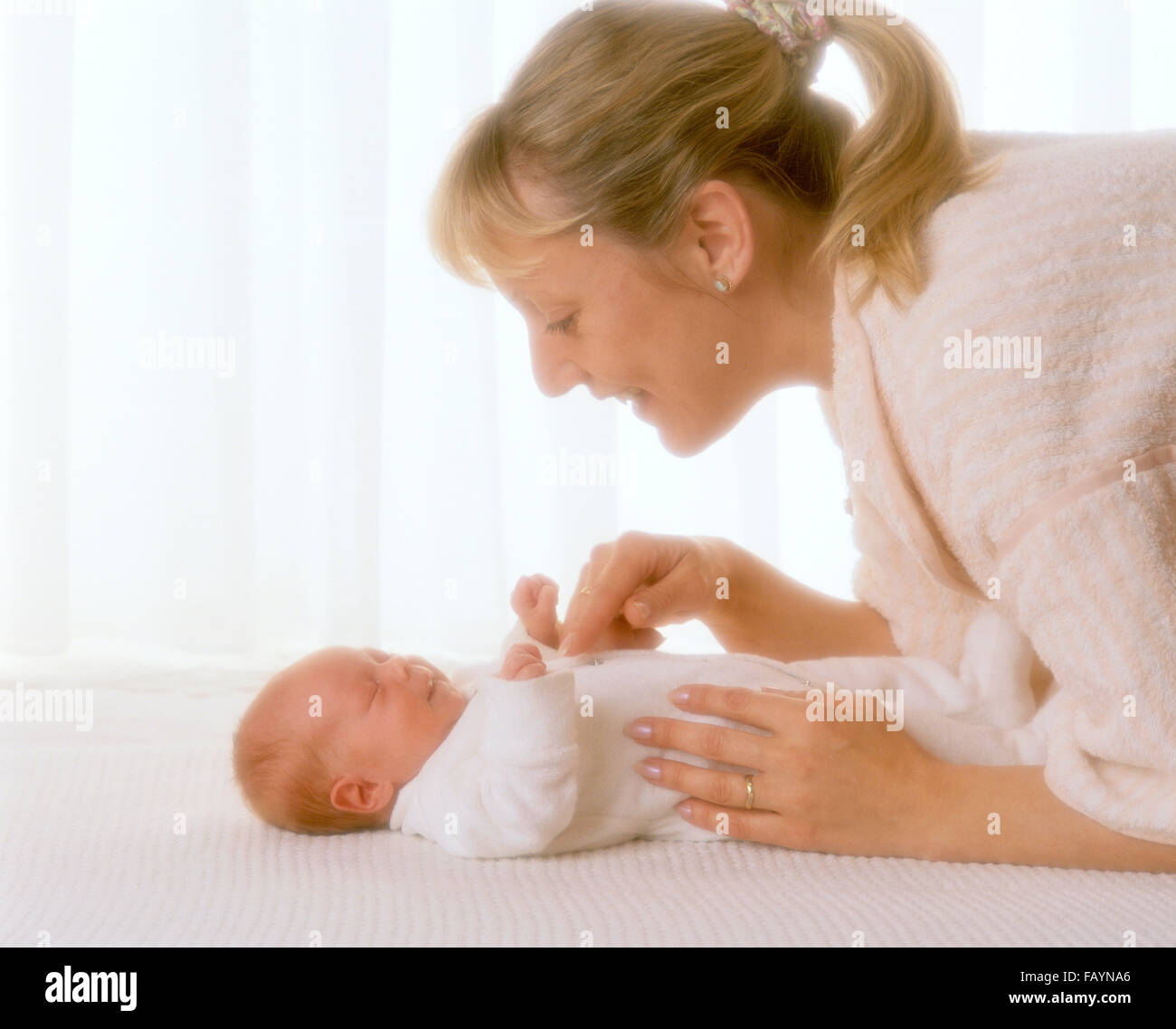 Mother and young baby - Stock Image