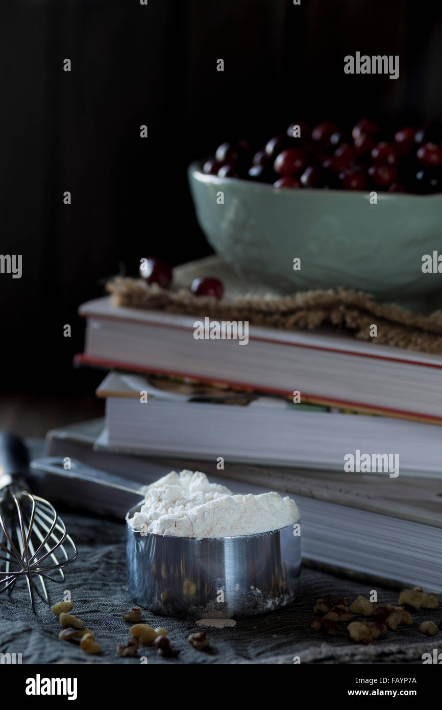 Baking, flour, whisks and cookery books - Stock Image