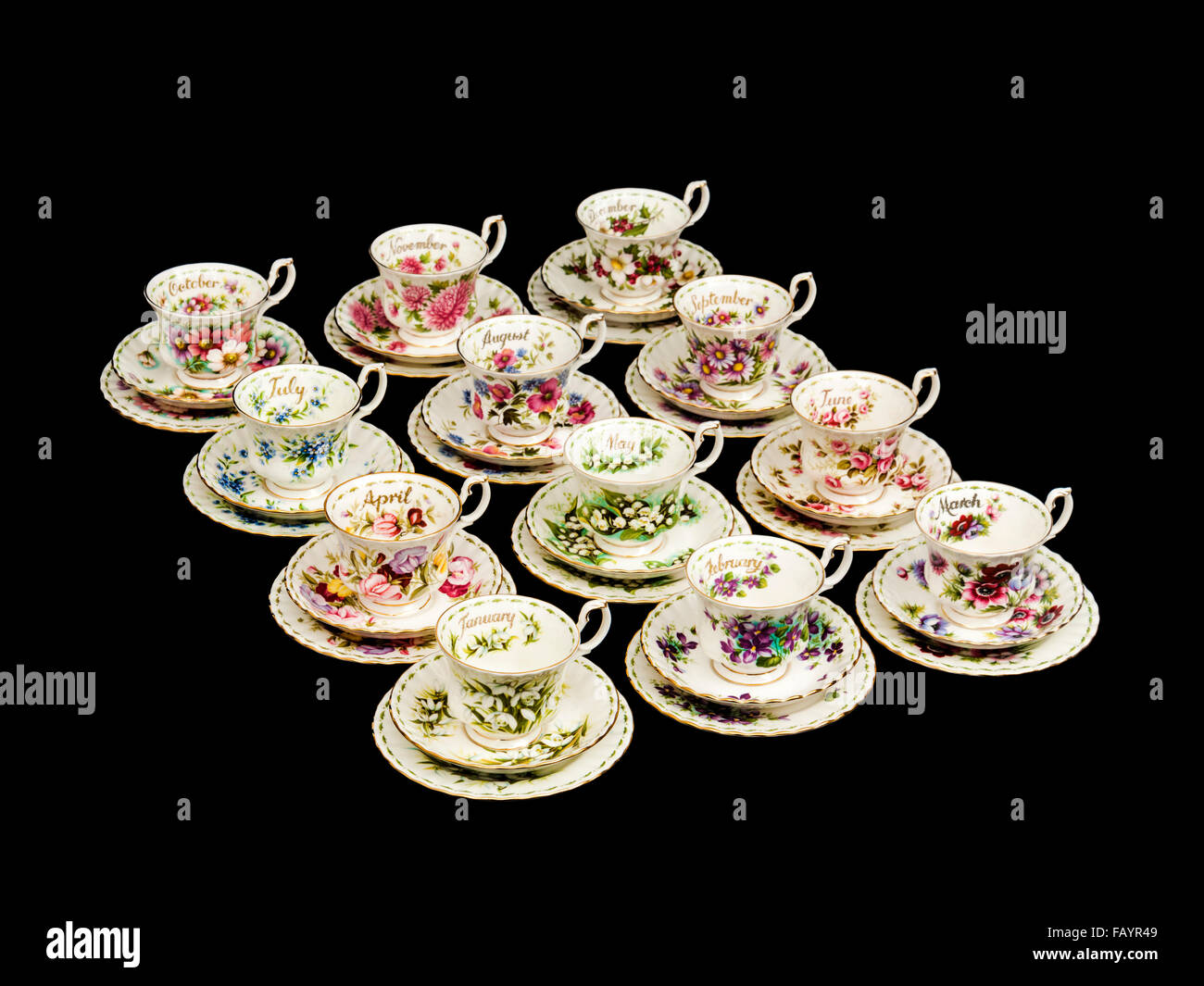 Full set of vintage Royal Albert porcelain 'Flowers of the Month' cups and saucers with side plates (trios) - Stock Image