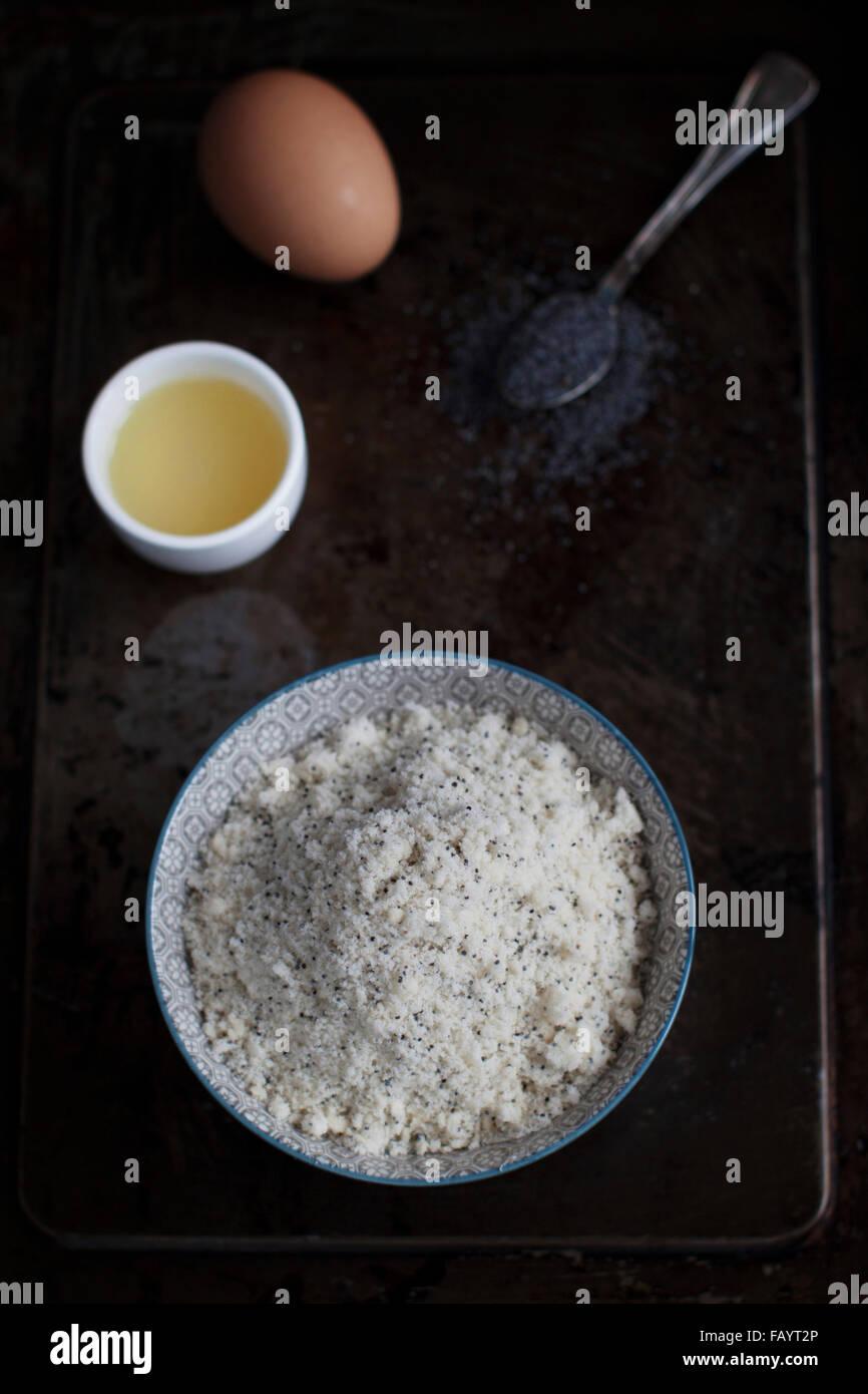 Work in progress for lime poppy seed cake: preparing the batter - Stock Image