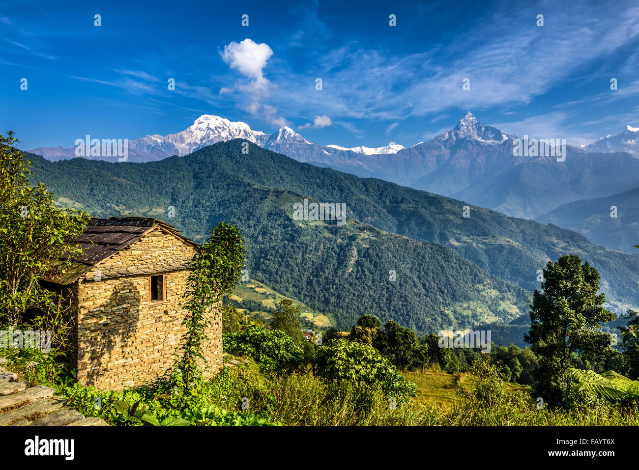 Himalaya mountains and old stone cabin near Pokhara in Nepal - Stock Image