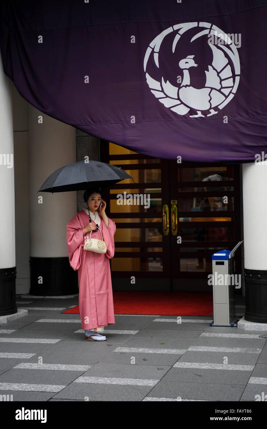 A woman at the entrance of the Kabuki-za theater, Ginza, Tokyo, Japan - Stock Image