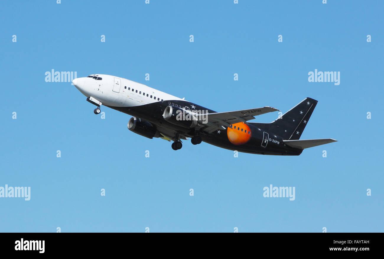 Titan Airways Boeing 737-3L9,leaves Edinburgh Airport - Stock Image