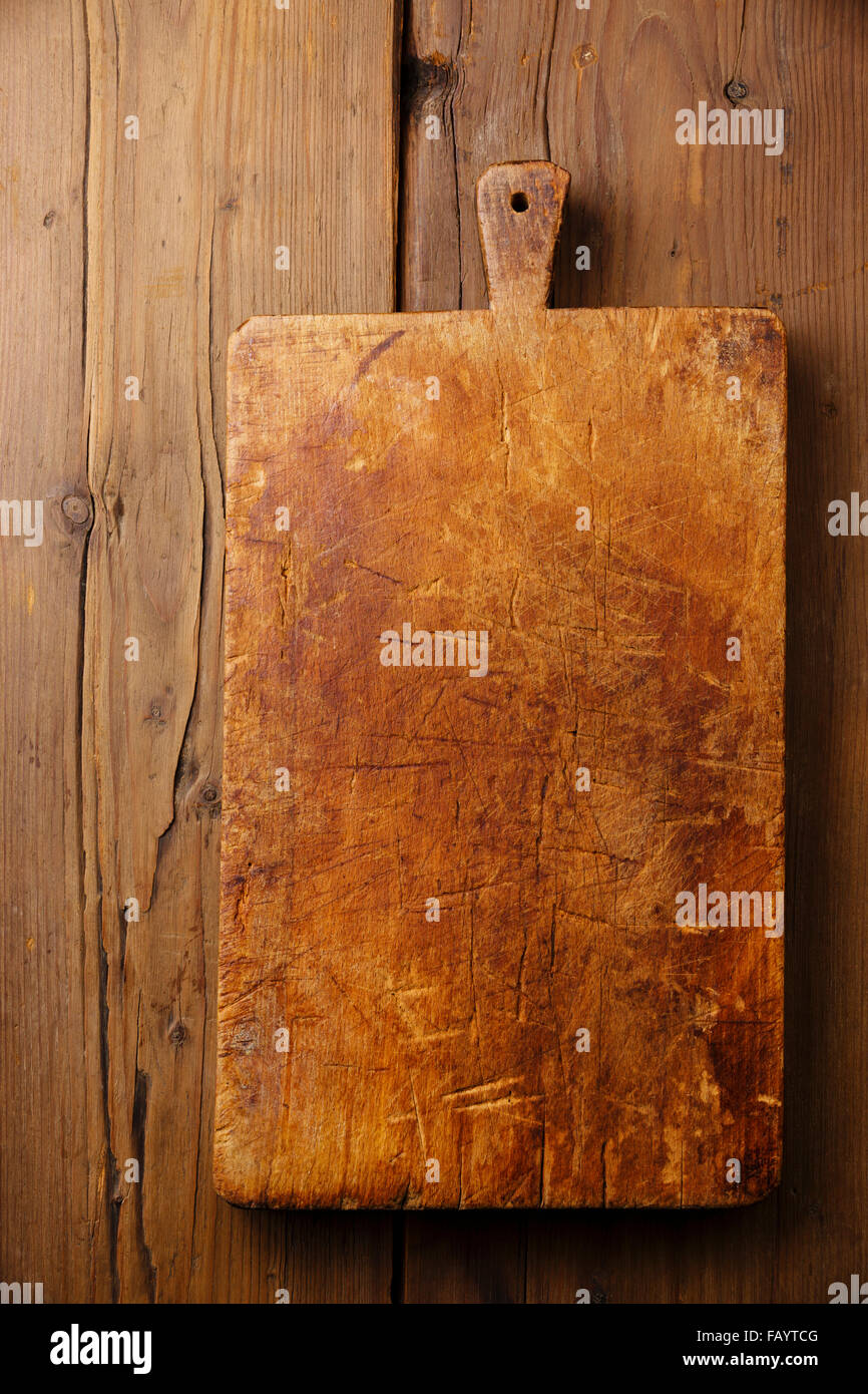 Chopping cutting board block on wooden texture background - Stock Image