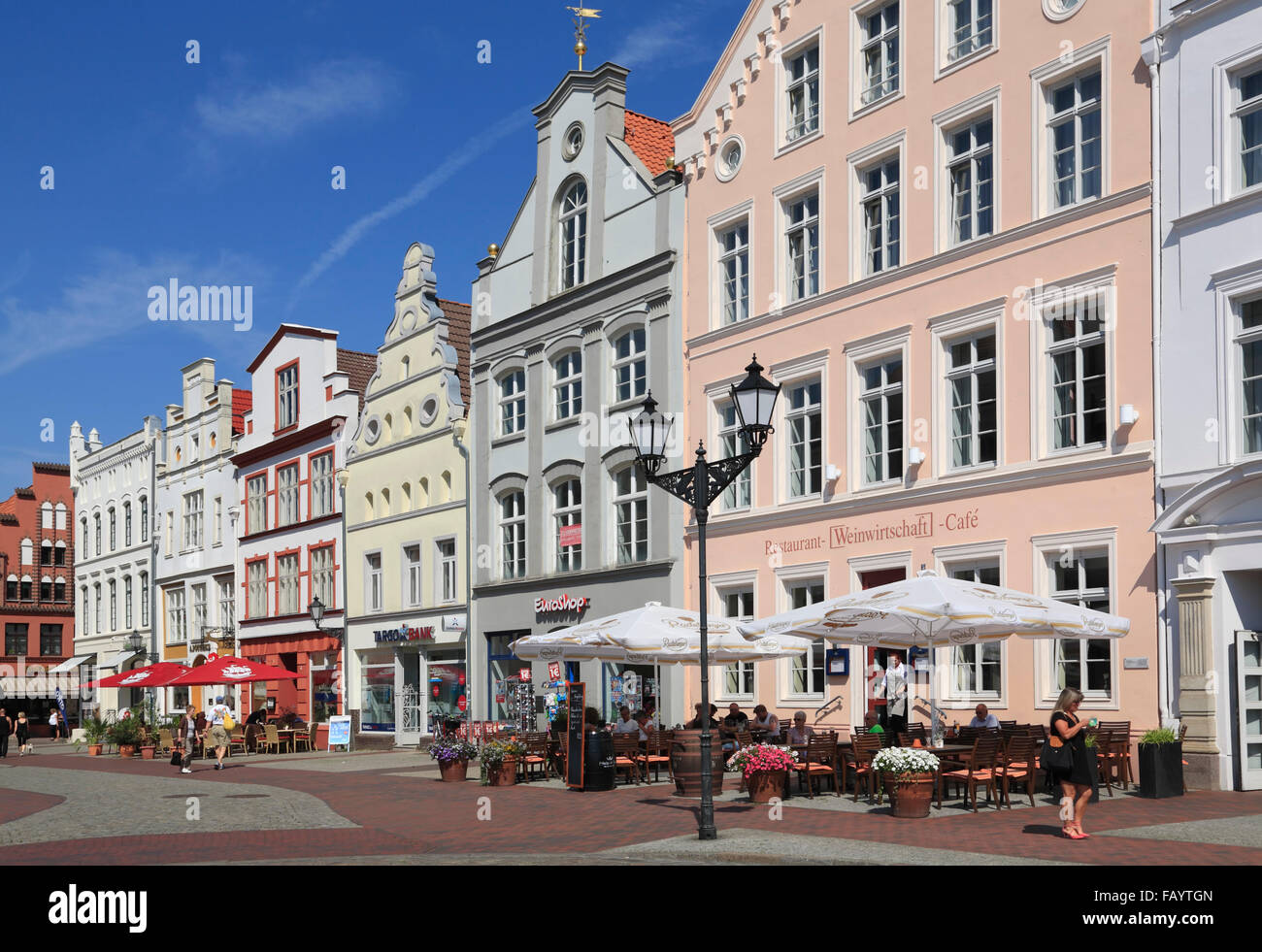 Houses with cafes and restaurants at market square, Wismar, Baltic Sea, Mecklenburg Western Pomerania, Germany, Stock Photo