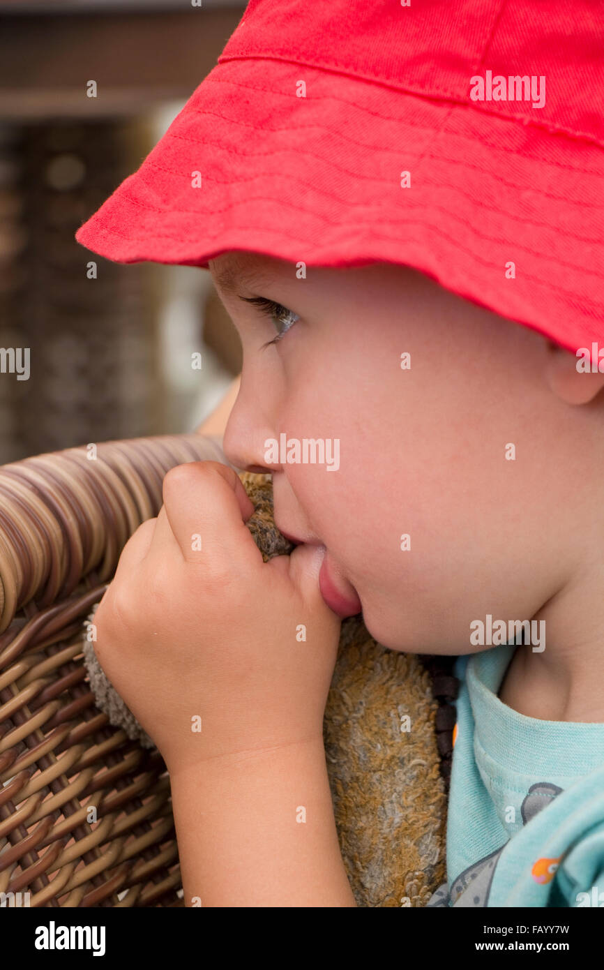 Young boy of three years old sucking his thumb - Stock Image