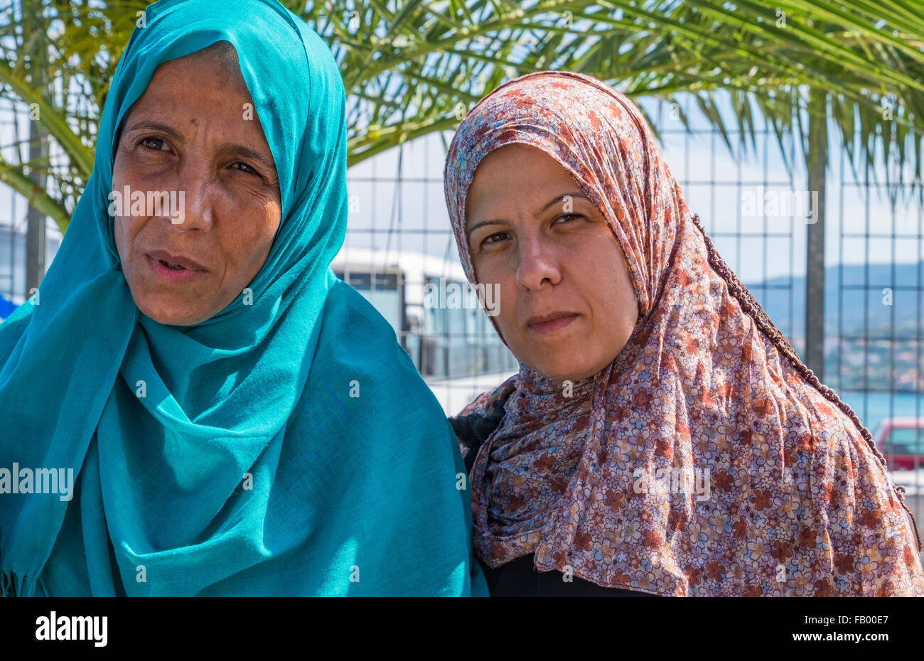 Two Syrian refugee women in traditional hijabs arrive in the port city of Mytillene, Lesvos after crossing from - Stock Image
