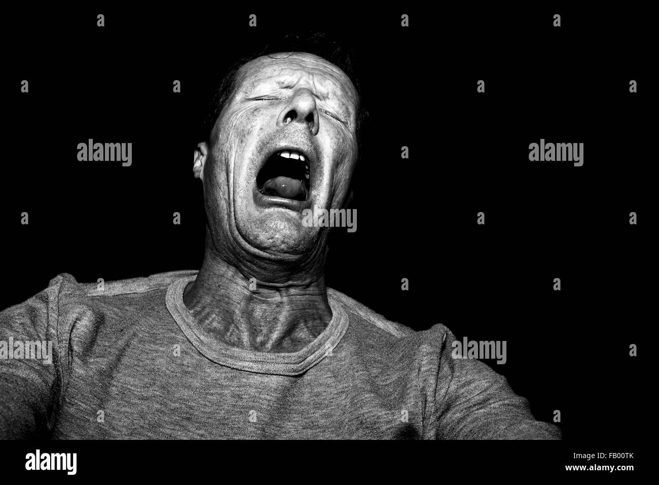Man having an asthmatic coughing attack. - Stock Image